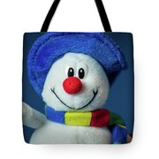 A Cute Little Soft Snowman With A Blue Hat And A Colorful Scarf Tote Bag