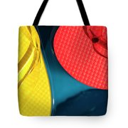 Multicolored Flip Flops Floating In Pool Tote Bag