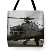 Ah-64 Apache Helicopter On The Runway Tote Bag