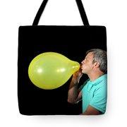 Man Inflating Balloon Tote Bag
