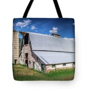 Summer Sunset With A Red Barn In Rural Montana And Rocky Mountai Tote Bag