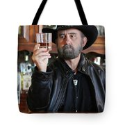A Bearded Cowboy In Black Contemplates His Whiskey In A Saloon Tote Bag