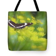 A Beautiful Swallowtail Butterfly On A Yellow Wild Flower Tote Bag