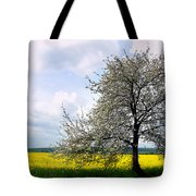 A Blooming Tree In A Rapeseed Field Tote Bag