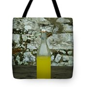 A Bottle Of Limoncello Sits On A Picnic Tote Bag