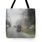 A Buggy Travels Down A Road In Spring Tote Bag