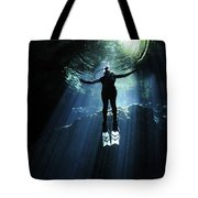 A Cavern Diver Ascends In The Cenote Tote Bag by Karen Doody