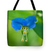 A Close-up Of A Bright Blue Flower Tote Bag