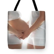 A Couple Expecting A Baby Touching A Belly. Tote Bag