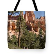 A Couple Hikes Along A Trail In Bryce Tote Bag