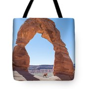 A Couple Kissing Under Delicate Arch In  The Arches National Par Tote Bag