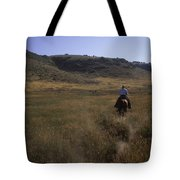 A Cowboy Looks For His Herd Tote Bag