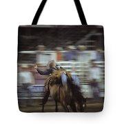 A Cowboy Rides A Bucking Bronco Tote Bag