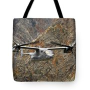 A Cv-22 Osprey Flies Over The Canyons Tote Bag
