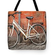 A Dejected Bicycle Waits Patiently On A Cobbled Street In Rome. Tote Bag