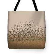 A Flock Of Birds Swarming A Field Tote Bag