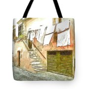 A Glimpse Of A House With Hanging Clothes Tote Bag