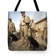 A Group Of Dog-handlers Conduct Tote Bag by Stocktrek Images