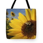 A Honey Bee Visiting A Sunflower Tote Bag