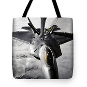 A Kc-135 Stratotanker Refuels A F-22 Tote Bag by Stocktrek Images