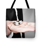 A Male Model Showcasing Cuff Links In His Hand Tote Bag
