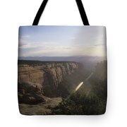A Man Admires The Sunset From A Canyon Tote Bag