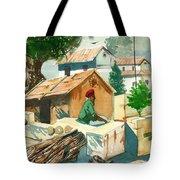 A Man Sitting Near A Tropical Village House Tote Bag