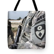 A Military Police Officer Provides Tote Bag by Stocktrek Images