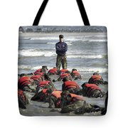 A Navy Seal Instructor Assists Students Tote Bag
