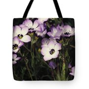 A Patch Of Wildflowers With White Tote Bag