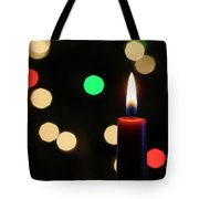 A Red Christmas Candle With Blurred Lights Tote Bag