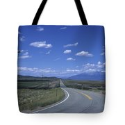 A Road Disappears Into The Distance Tote Bag
