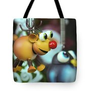 A Rudolph The Red Nosed Reindeer Ornament With A Penguin Tote Bag