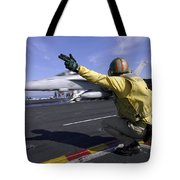 A Shooter Signals The Launch Of An Tote Bag