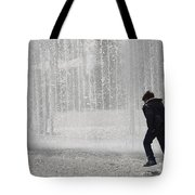 A Silhouette Of The Boy Against A Fountain Tote Bag