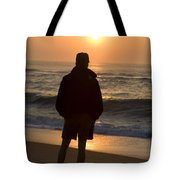 A Silhouetted Figure Enjoys The Ocean Tote Bag
