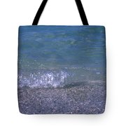 A Small Wave Ripples Onto Shore Tote Bag