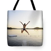 A Swimmer Jumps Off A Diving Board Tote Bag