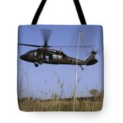 A U.s. Army Uh-60 Black Hawk Helicopter Tote Bag by Stocktrek Images