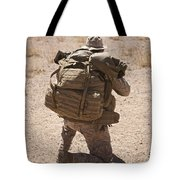 A U.s. Marine Pulls Security While Tote Bag