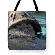A U.s. Marine Swims Across A Training Tote Bag