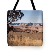A View Down Into The Canyon That Forms Tote Bag