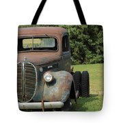 A Vintage Truck On A Yard Tote Bag