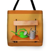 A Watering Can Of  Aluminium And A Plastic One Laid On Wooden Bench Tote Bag