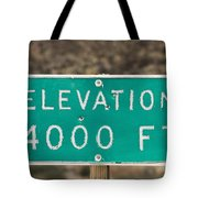 A Weathered Elevation Sign On Highway Tote Bag
