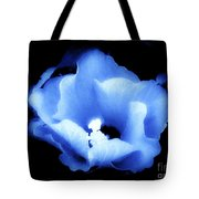A White Hibiscus Bloom With Blue Tinge On Black Background Tote Bag