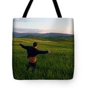 A Young Boy Runs Through A Field Tote Bag