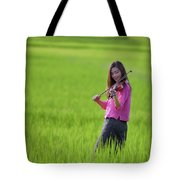 A Young Girl In A Folk Costume Plays A Vivaro In A Green Rice Fi Tote Bag