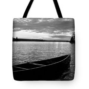 Abandoned Canoe Floating On Water Tote Bag