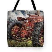 Abandoned Old Farmall Tractor In A Grassy Field Tote Bag